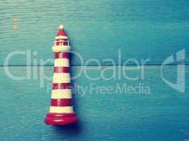 Lighthouse on blue wood