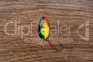 Fishing lure on the old wooden table.