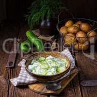 fresh cucumber salad with yogurt and young potatoes