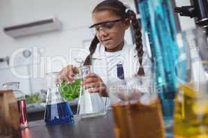 Elementary student doing scientific experiment at laboratory