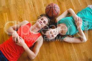 Overhead portrait of friends in basketball court