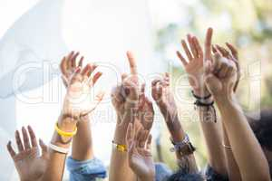 Fans with arms raised at music festival