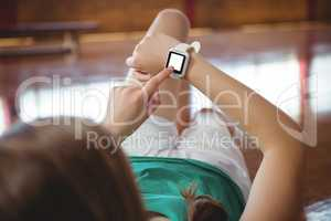 Woman using smart watch in basketball court