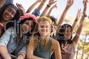 Happy female friends at music festival