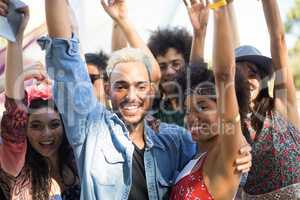 Portrait of happy friends enjoying during music festival