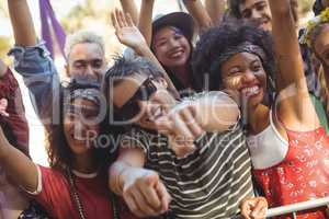 Cheerful man with friends enjoying at music festival