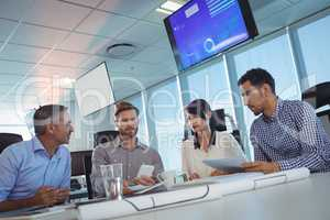 Tilt image of business people discussing at office