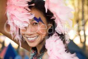 Portrait of happy woman holding fur scarf