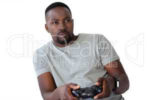 Man playing video game against white background
