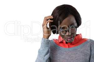 Confused woman with hand in hair