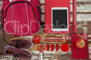 Bagpack, shoes, digital tablet, apple and stationary