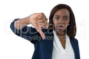 Businesswoman showing thumbs down