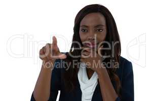 Confused businesswoman with hand on chin using interface screen