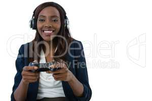 Cheerful businesswoman playing video game