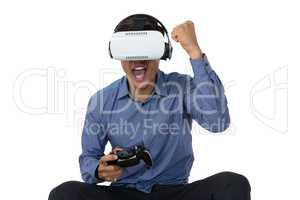 Businessman using vr glasses while playing video game