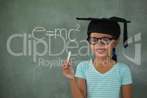 Young girl with graduation hat holding chalk