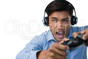 Young businessman making face while playing video game