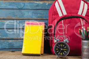 Bagpack, books, alarm clock and pen holder