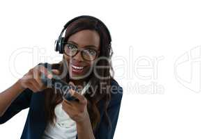 Woman wearing eyeglasses and headphones while playing video game