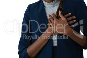 Mid section of woman suffering from chest pain