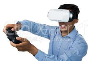 Creative young businessman wearing vr glasses while video game