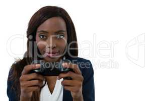 Close up portrait of businesswoman playing video game