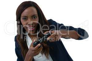 Young businesswoman playing video game