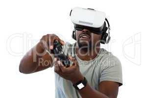 Man using virtual reality headset and playing video game