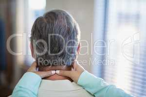 Close-up of female therapist massaging neck to male patient