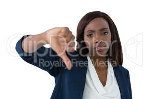 Close up portrait of businesswoman showing thumbs down