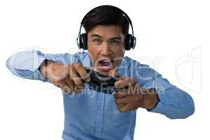 Businessman making face while playing video game
