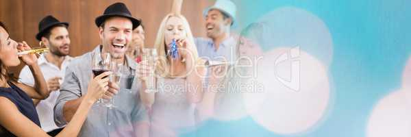 Group of people drinking alcohol and partying wide shot