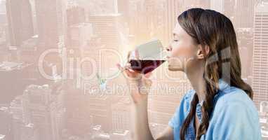 Woman tasting wine against blurry skyline