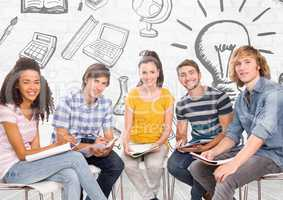 Group of students sitting in front of education learning graphics