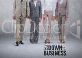 Group of business people standing in front of blank grey background with Down to Business text