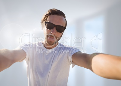 man taking casual selfie photo in front of blurred background