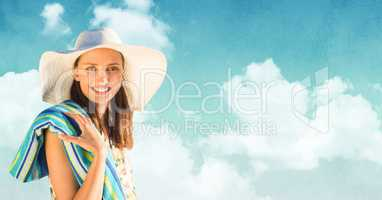 Woman in sun hat with towel against Summer sky