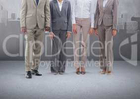 Group of business people standing in front of blank grey background with cityscape
