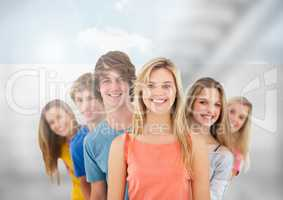 Group of young people standing in front of blurred background