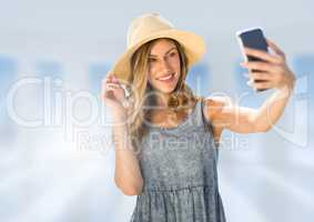 Woman taking casual selfie photo in front of blurred background