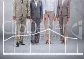 Group of business people standing in front of blank grey background with statistic chart