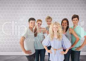 Group of young adults standing in front of bright wallpaper background