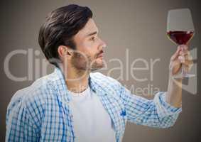 Man tasting wine against brown background
