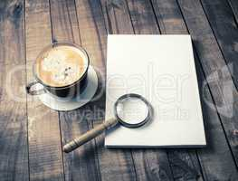Booklet, magnifier, coffee cup