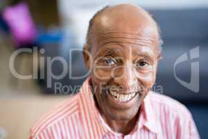 Portrait of smiling senior man with receding hairline