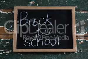 Back to school text written on chalkboard