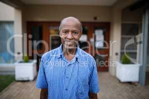 Portrait of smiling senior man at nursing home