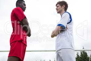 Low angle view of young male soccer players looking at each other