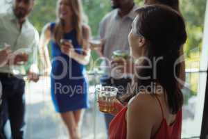 Woman having cocktail drink with friends