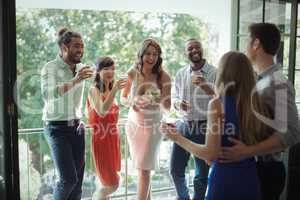 Group of friends having cocktail drink while interacting each other